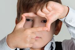 Boy focusing at you Royalty Free Stock Images