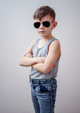 Boy with folded arms and sunglasses Royalty Free Stock Image