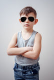 Boy with folded arms and sunglasses Royalty Free Stock Images