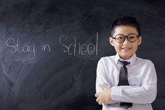 Boy folded hands with text of Stay in School Royalty Free Stock Photography