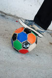Boy foot on old soccer ball Stock Photography
