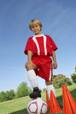 Boy With Foot On Soccer Ball Stock Images