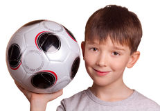 The boy with a football. Isolated on white Stock Photo