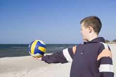 Boy with football on beach Royalty Free Stock Image