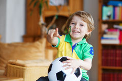 Boy football fan showing emotions for winning his team. Little boy football fan showing emotions for winning his soccer team Royalty Free Stock Photo