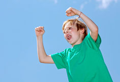 Boy football fan on sky background Stock Image