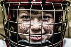 Boy With a Football Helmet Smiling Stock Photos