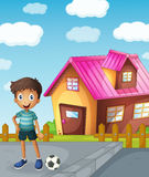 A boy, football and house. Illustration of a boy, a football and a house Stock Photo