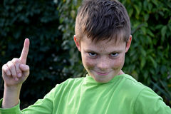 Boy with forefinger gesture Royalty Free Stock Images