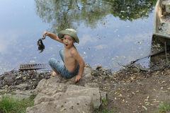 Boy in forest by lake Royalty Free Stock Photos