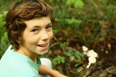 Boy in the forest with puffball mushrooms Royalty Free Stock Images