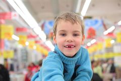 Boy without foreteeth in shop Royalty Free Stock Photography