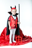 The boy in the form of imp Royalty Free Stock Photography