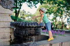 The boy at a fountain Royalty Free Stock Photo