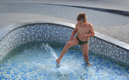 Boy in the fountain Royalty Free Stock Photos