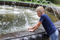 Boy at the fountain Royalty Free Stock Photography