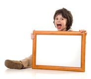 The boy with a frame Stock Photos