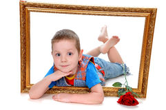 Boy in the frame of the picture - a gift on Valentine& x27;s Day Royalty Free Stock Images