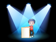 A boy with a framed signage at the stage Royalty Free Stock Image