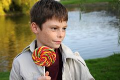 Boy with freckles enjoys  lolly