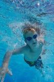 Boy freestyle swimming. Underwater shot Royalty Free Stock Image