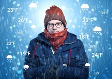 Boy freezing in warm clothing with weather condition concept Stock Photos