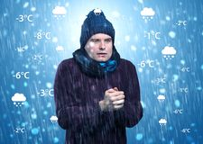 Boy freezing in warm clothing with weather condition concept Stock Image