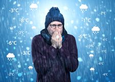 Boy freezing in warm clothing with weather condition concept Royalty Free Stock Image