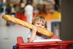 Boy with french bread Stock Photos
