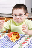 Boy with french fries Royalty Free Stock Photo