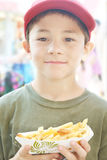 Boy with French Fries Stock Photos