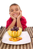 Boy and fresh fruit. Healthy child and fresh fruits Stock Photography