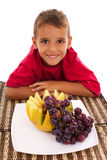 Boy and fresh fruit. Healthy child and fresh fruits Royalty Free Stock Photos