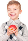 Boy with fresh red apple Stock Photography