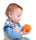 Boy and fresh rustic orange Royalty Free Stock Images