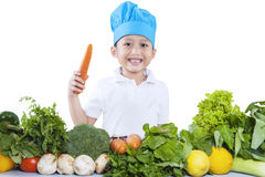 Boy with fresh vegetables - isolated Royalty Free Stock Photography