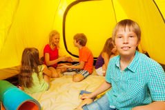 Boy with friends in camping tent Stock Image