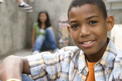 Boy (13-15) by friends, smiling, portrait, close-up Stock Photography