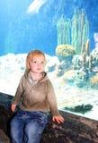 Boy in front of aquarium Stock Photo