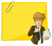 A boy in front of the big empty paper with a clip Stock Photos