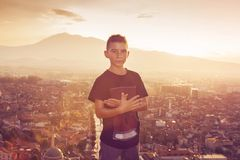 Boy in front of the city of prizren Royalty Free Stock Images