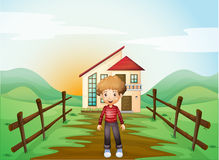 A boy in front of the concrete house in the hilltop Royalty Free Stock Photos