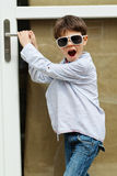 Boy in front of the door Royalty Free Stock Photo