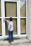 Boy in front of the door Royalty Free Stock Photos