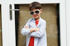 Boy in front of the door Royalty Free Stock Photography