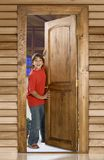 Boy at front door royalty free stock image