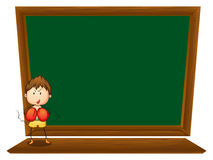 A boy in front of the empty blackboard Royalty Free Stock Photo