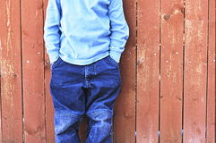 Boy in front of fence Royalty Free Stock Photos