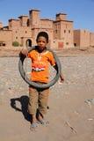 Boy in front of Kasbah in Skoura Stock Images
