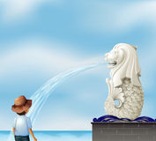 A boy in front of the Merlion statue Stock Photography